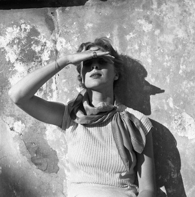 Woman shielding eyes from sun